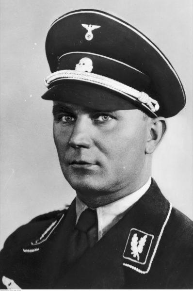 Arthur Karl Greiser, niemiecki działacz nazistowski, fotografia portretowa w mundurze SS, lata 1931–1934, autor nieznany. Źródło: Narodowe Archiwum Cyfrowe